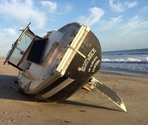 sail-boat-off-the-beach